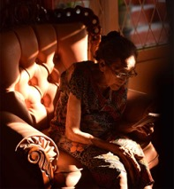 older woman reading in chair